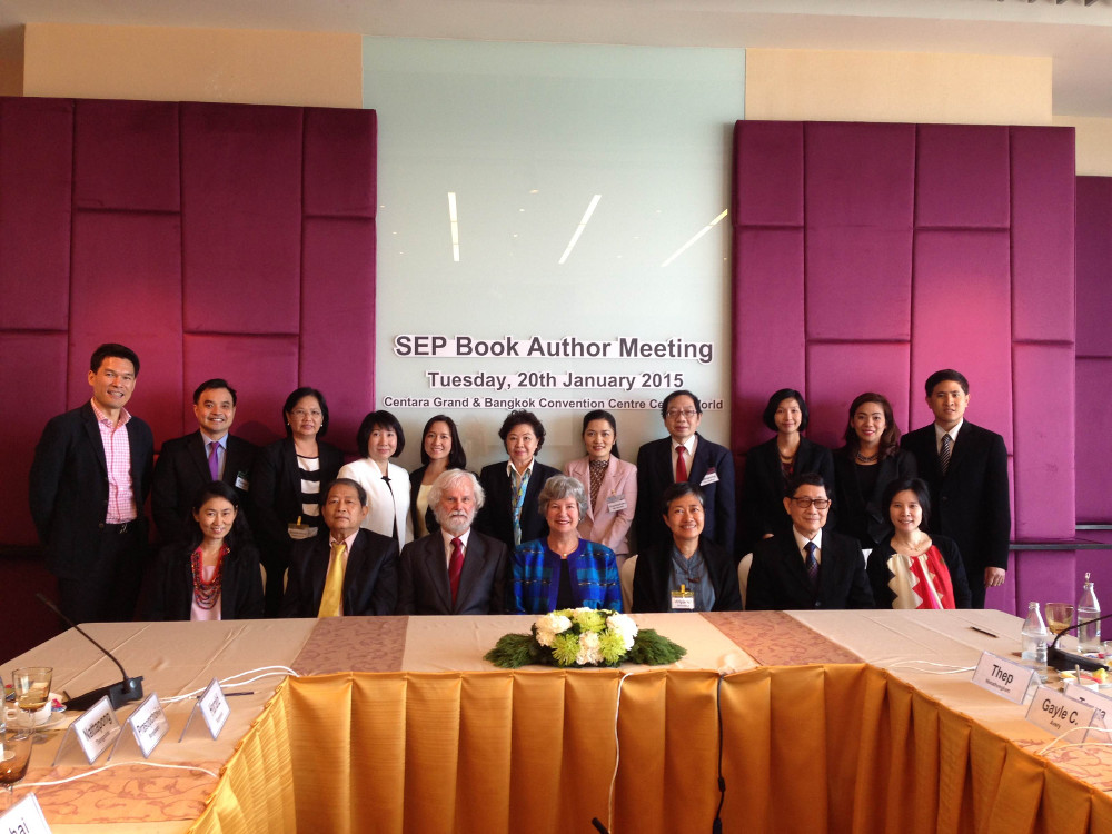Book authors at a meeting in Bangkok.
